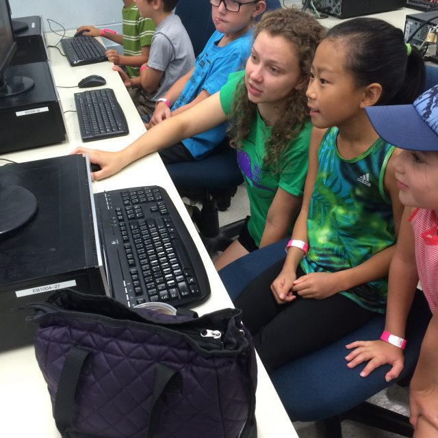 Image of summer camp participants coding